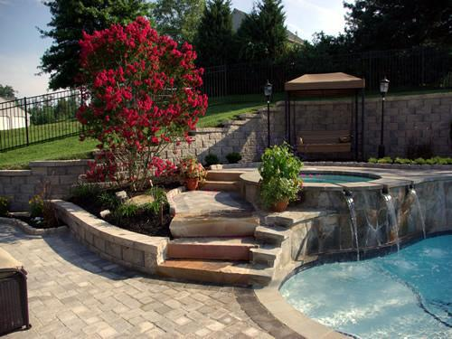 Hot-tub-with-water-fall-landscaping-photo