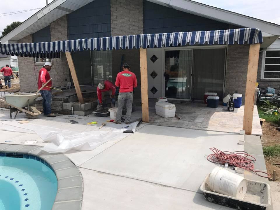 Woodfield-team-working-on-custom-patio