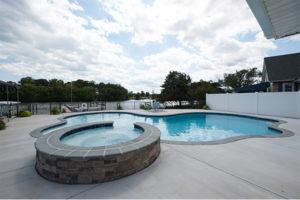 custom-backyard-installation-hottub-and-pool