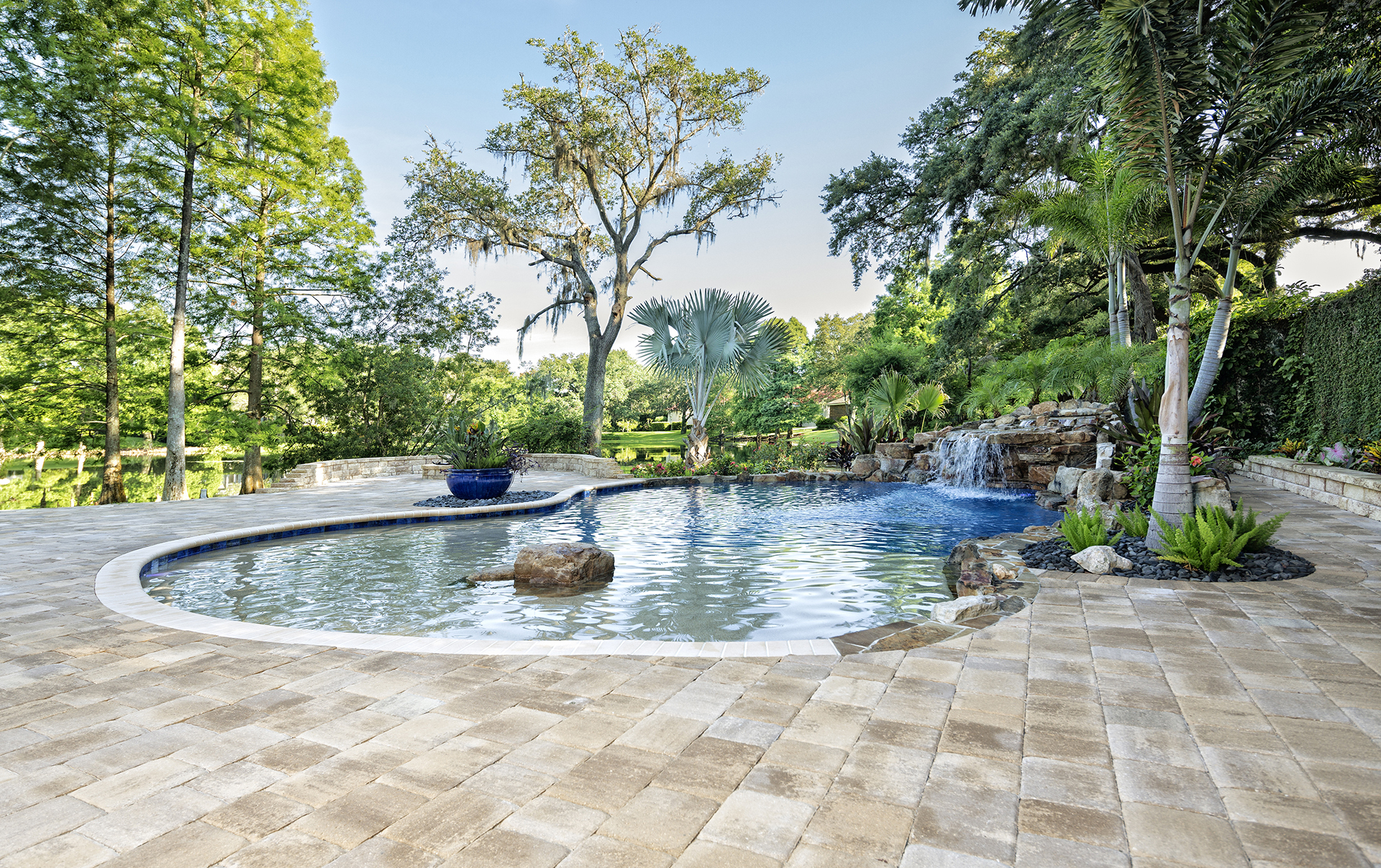 Beautifully Landscaped Swimming Pool With Waterfall At Estate Home
