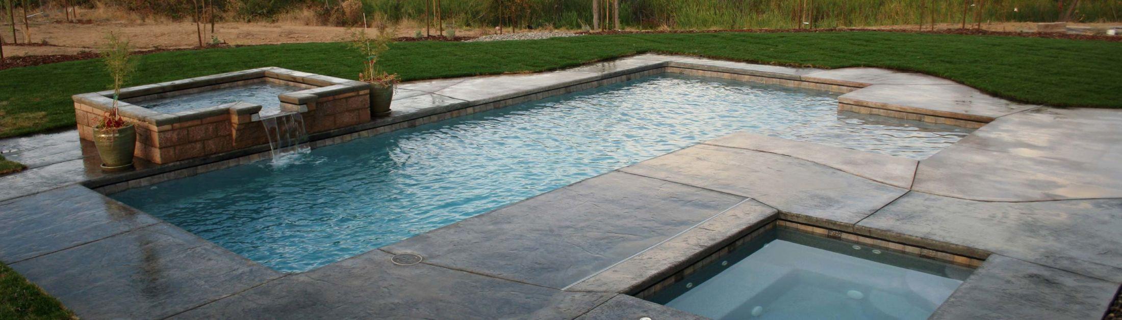 masonry-stone-wall-waterfall-and-pool