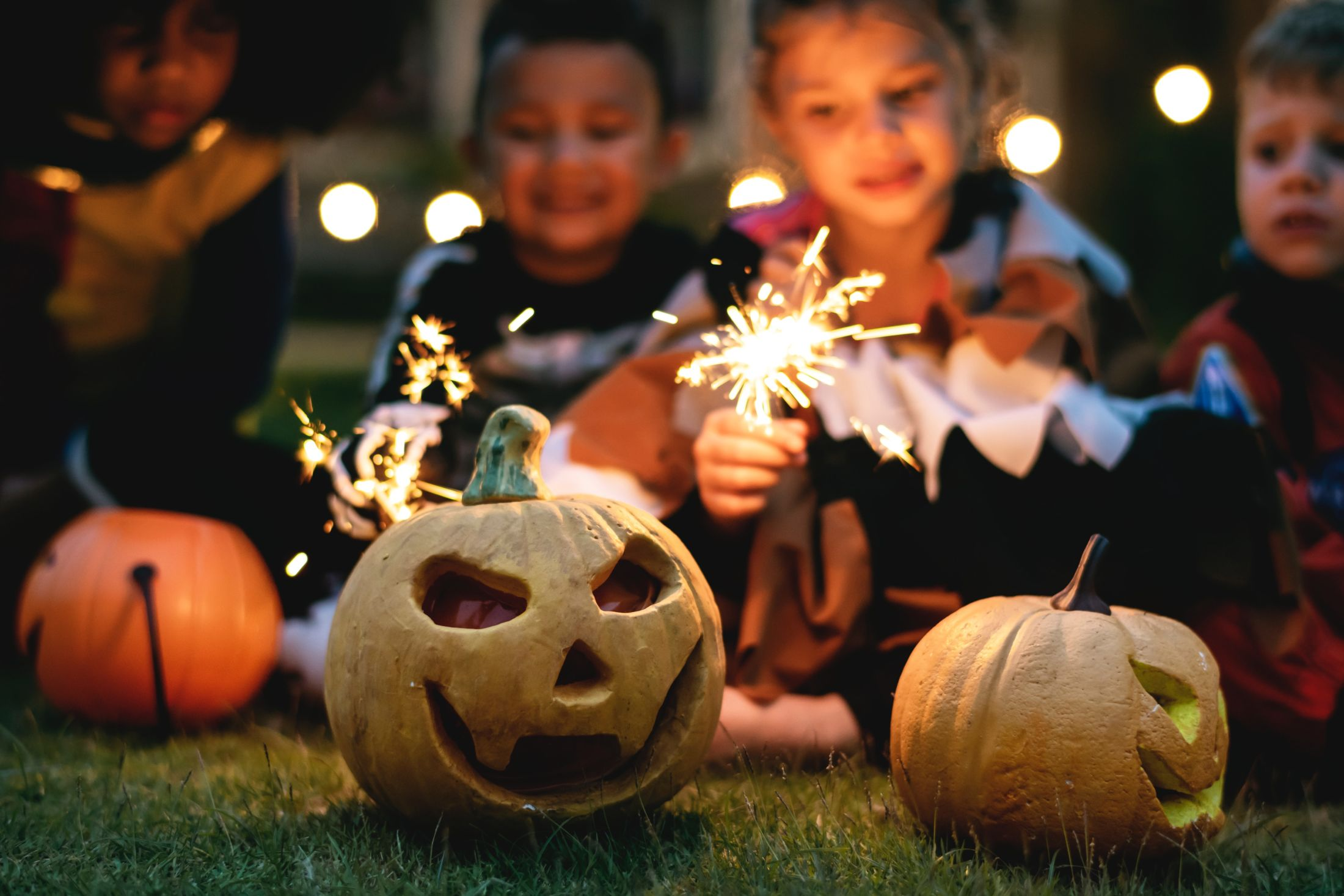 Halloween-pool-party-spook-lagoon-kids-with-pumpkins-image