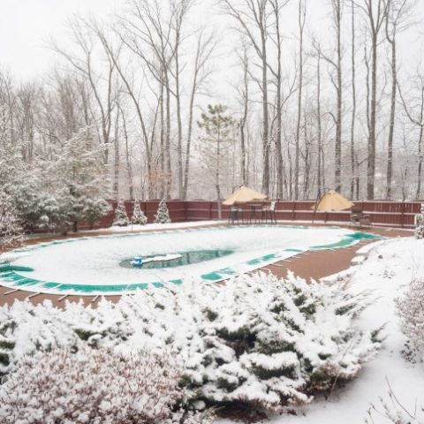 pool-covered-in-winter-snow
