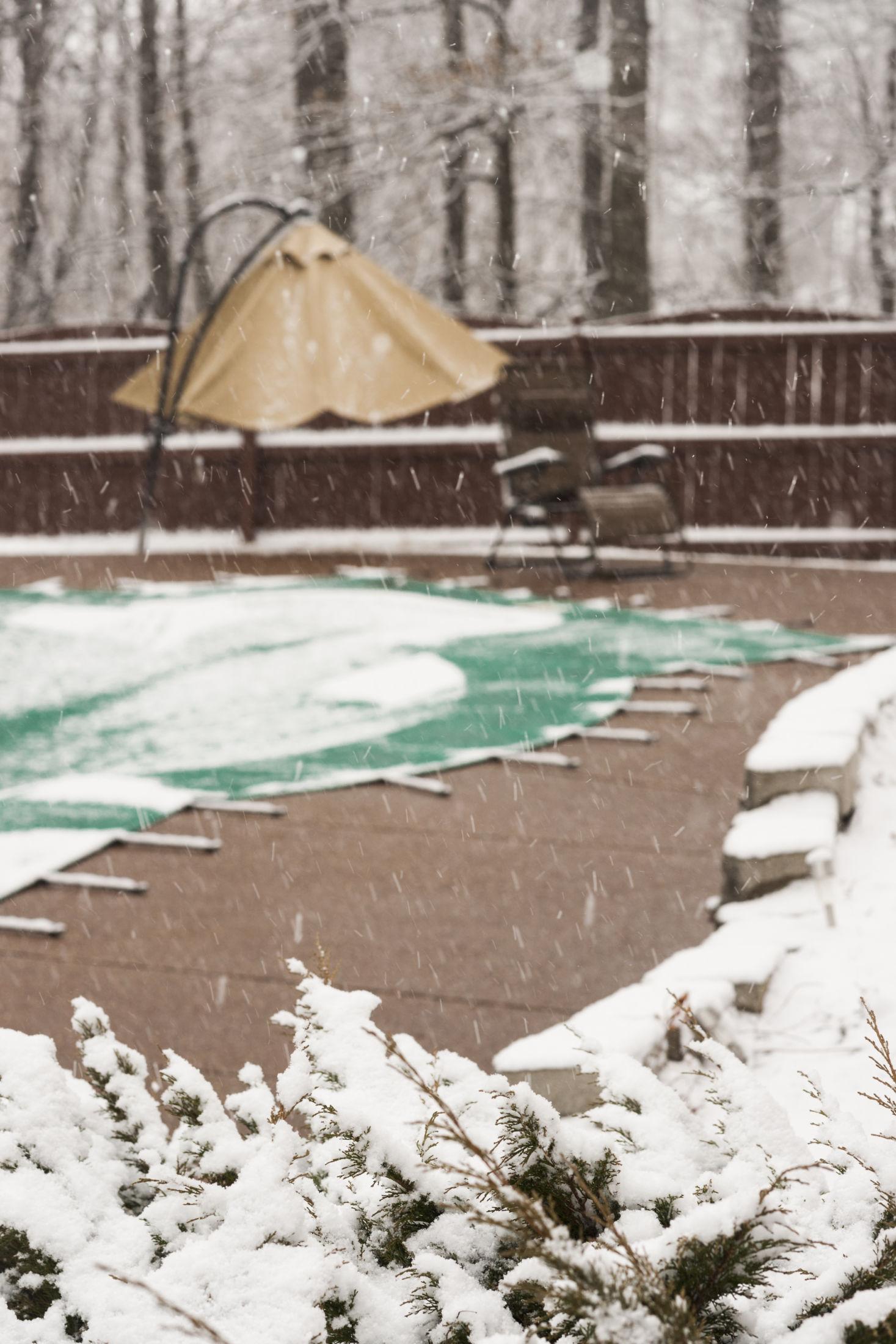 Winter-pool-cover-snow-on-inground-pool