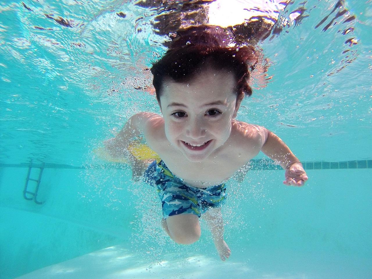 Child-swimming-in-inground-pool