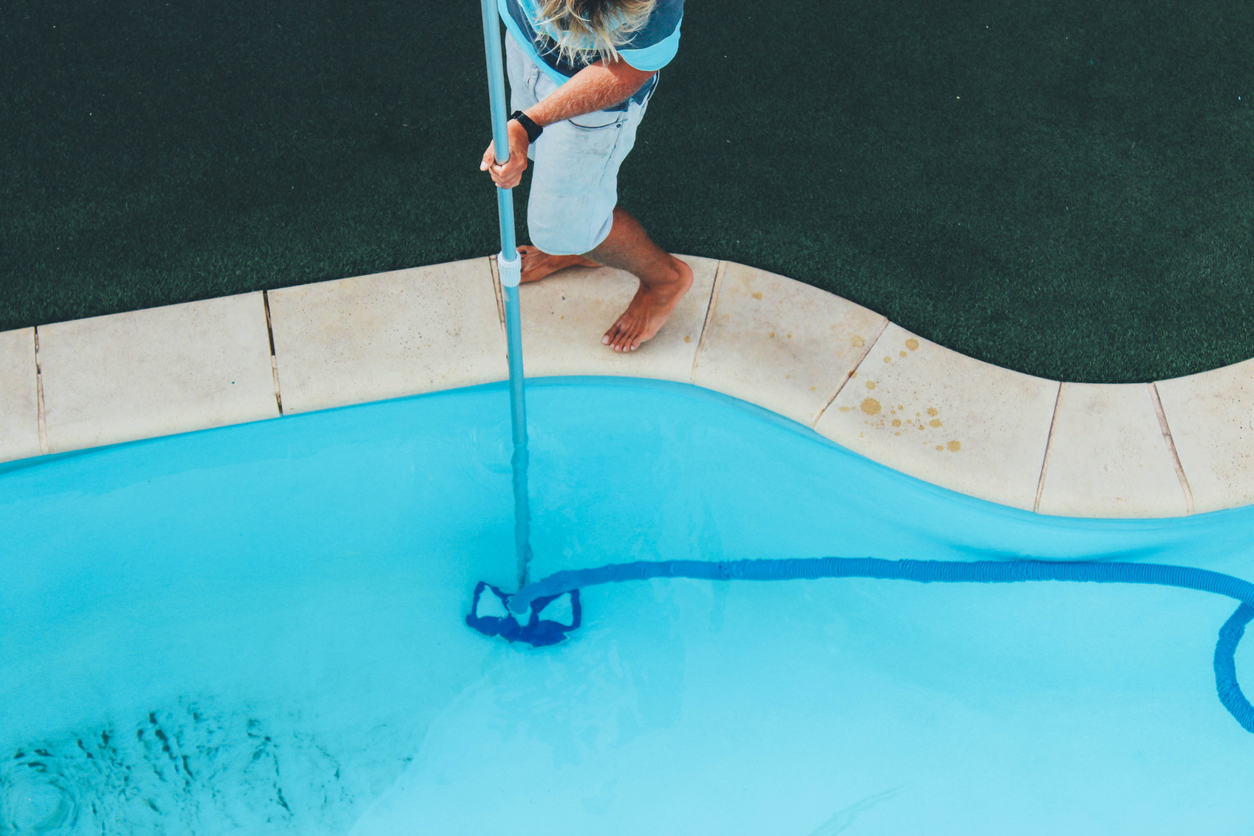 Pool-service-company-person-with-skimmer